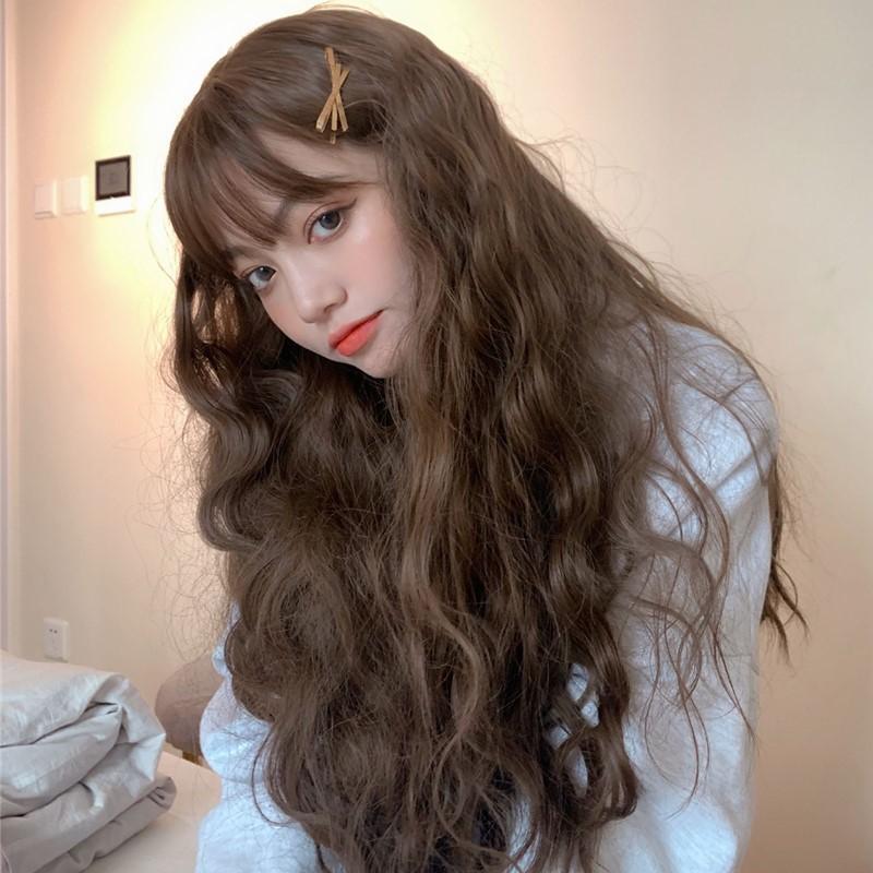 Tóc dài uốn xoăn xù