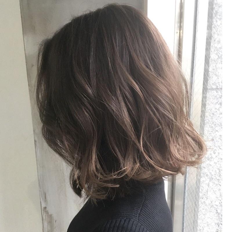 Tóc ngắn uốn xoăn lơi
